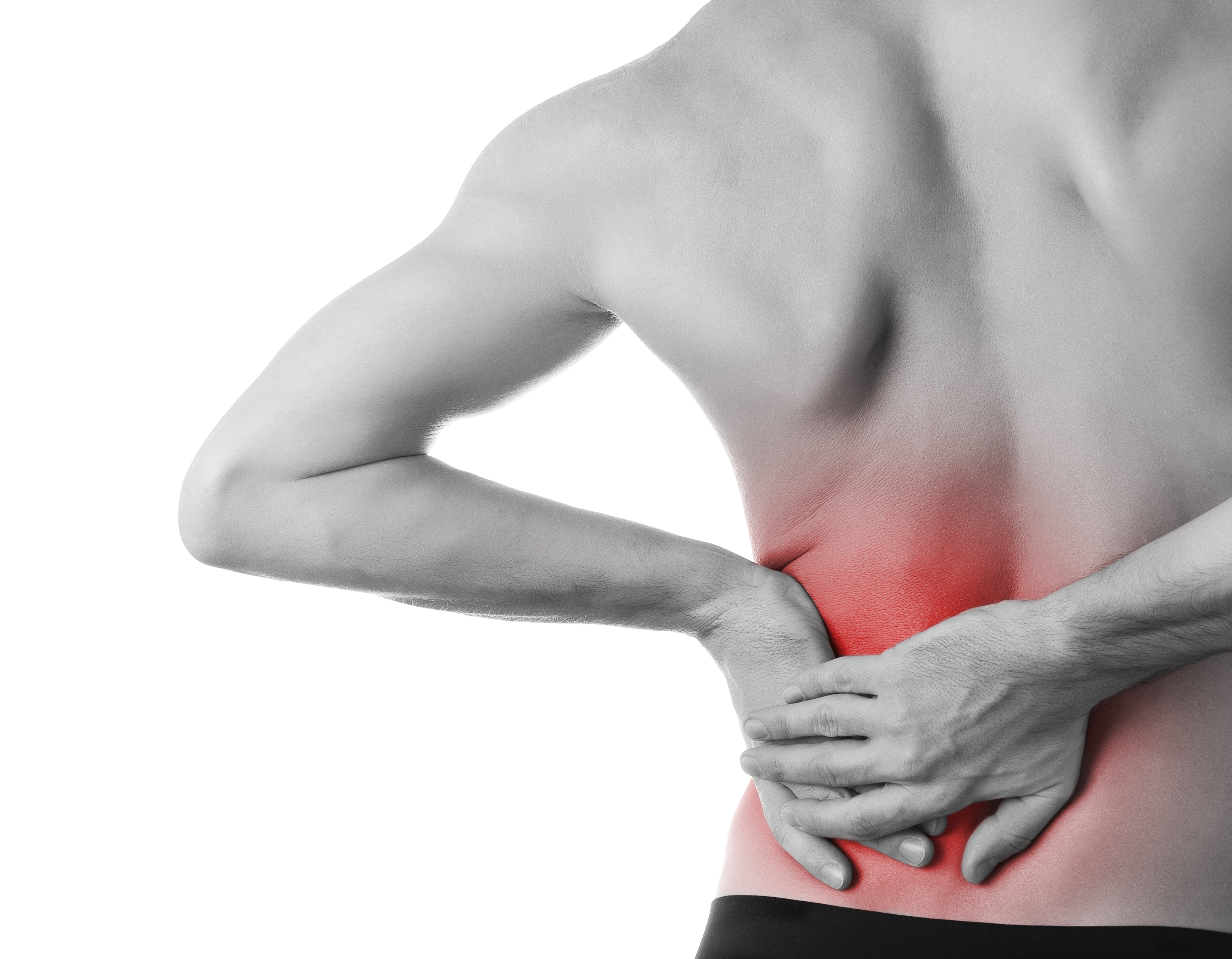Rear view of a young man holding his back in pain, isolated on white background, monochrome photo with red as a symbol for the hardening
